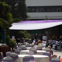 pool party, pool location, purple white combination decoration, simple party decoration, event management company