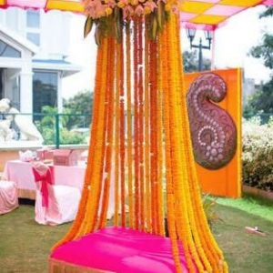 wedding mehndi ceremony, wedding planner in pune, backdrop, yellow, flowers, yellow and red decoration