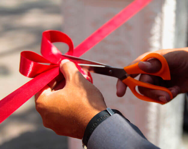 red ribbon cutting event, promotional, new shop opening